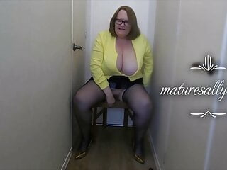 Granny in yellow cardigan and blue suspender tights