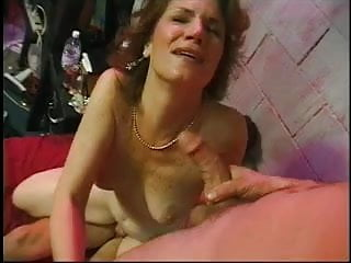Mature teacher is fucked hard by two studs and gets ball cream on her face