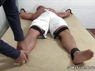 Feet lover tickles a big jock who is...