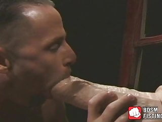 Slobbers massive dildo before riding it...