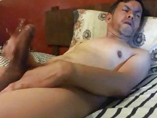 Wanking his...