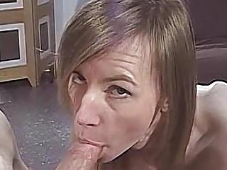 Skinny milf strips nude then sucks a big...