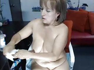 Mature dildo in her ass...
