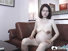 Desirable pregnant chick shows off her sexy belly
