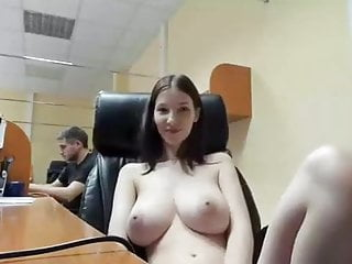 Young in an office next to her colleague...