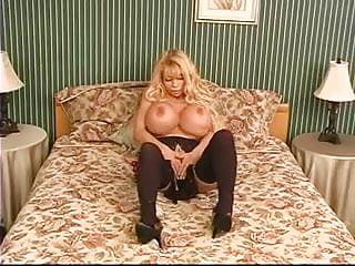 Blonde stuffs huge anal beads up her ass...