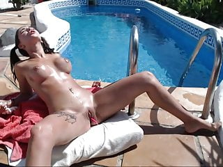 Amateur Girl Masturbating video: Sexy brunette naked and squirting on her swimming pool