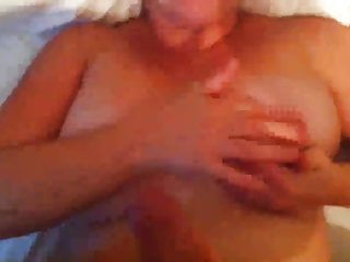 Jerking off while she plays with her tits