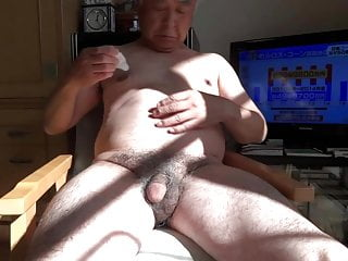 Naked old man sucks nipples and erections.