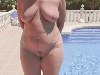 Woman naked round by the pool...