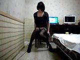 Asian crossdresser in black stockings rides dildo deep