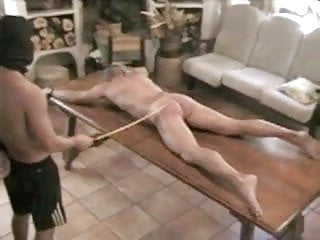 Caned on french farm table by group of men