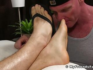 Muscular jock gets licked...