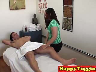 Asian massage babe jerking client cock...