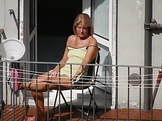 Italian Voyeur Blonde video: Tanned granny sunbathing on the balcony