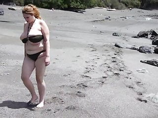 Huge boobs squirts in the sand...