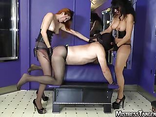Two topless femdom Mistresses anal punishment