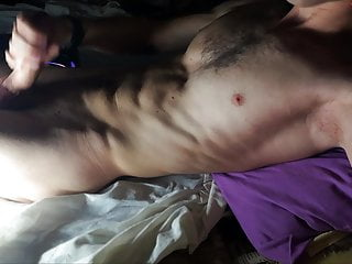 Sporty guy jerks off a big cock before going to bed