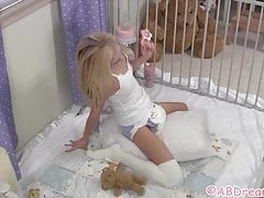 Diaper girl in playpen