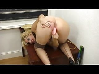 British slut Katie uses a dildo on herself in stockings