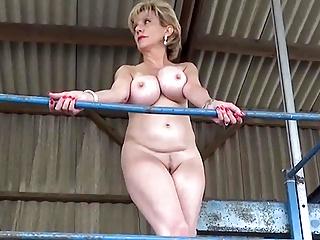 Strips her dress...