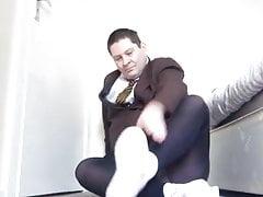 Transvestite in black tights and white socks