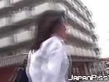 Shy Japanese schoolgirl filmed pissing loads outdoor