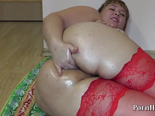 Irina, the fat Russian, sinks her hand into her hairy anus