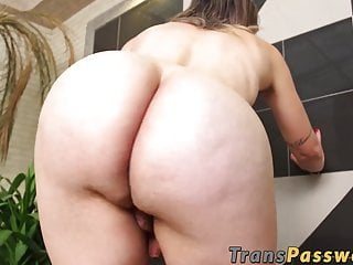 Tranny takes a BBC in the ass while jerking her hard dick