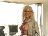 Sexy secretary shows her tits and pussy on the desk