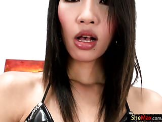Thai strokes rafes cock and her own...