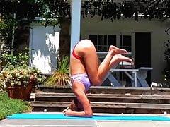 Nina Agdal looking hot doing yoga outdoors