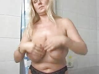 Blonde Milf  Lathers Lotion All Over Her Massive Knockers