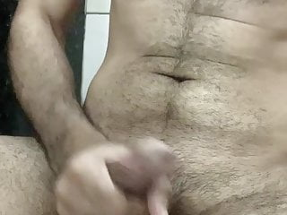 A guy masturbating in the bathroom