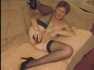 Playing with black dildo...