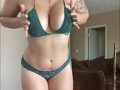 Sexy brunette is strip dancing in homemade video