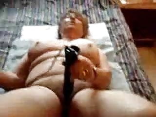 Mature playing Dildo