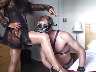 Mistress in nylons gives harsh handjob