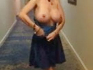 Public Nudity British Brunette video: Massive tit slut in Hotel Hallway