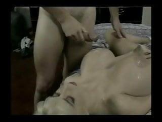 Giant tits sucks 2 big cocks...