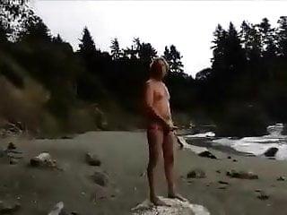 Stroking beach stranger finishes him off...