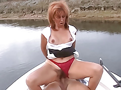 Gorgeous cougar has her hairy pussy stuffed on a boat