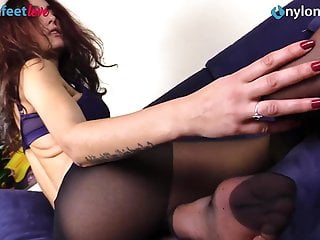Sexy redhead pantyhose shows and feet...