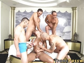Shemale Latina gangbanged by muscular group of big cocks