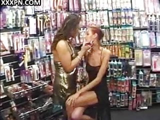 Lesbian hotty gets toy fucked in sex shop.