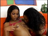 Two sexy black lesbians in red lingerie on couch sucking and dildo fucking