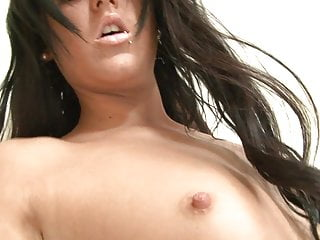 Young hottie with small tits lies sensually in bed