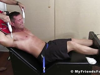 Strapped in to have his feet and body...