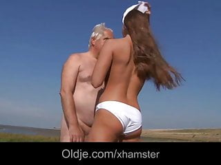 Big titty teen fucking older beach...