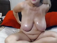 busty granny  spreads her pussy